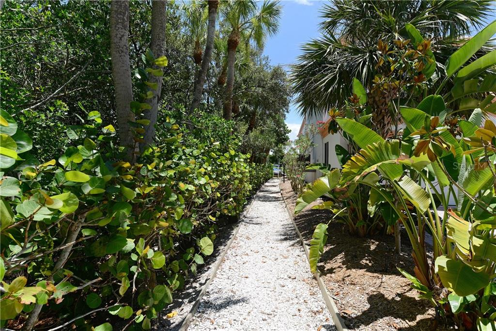 The walkway to the Weston Pointe Marina - Single Family Home for sale at 602 Weston Pointe Ct, Longboat Key, FL 34228 - MLS Number is A4178531