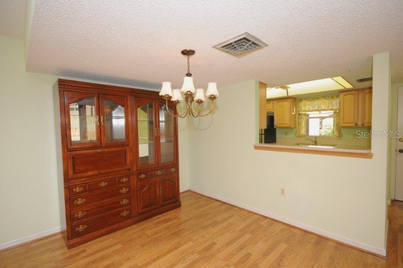 Dining area - Condo for sale at 2215 Circlewood Dr #46, Sarasota, FL 34231 - MLS Number is A4180138