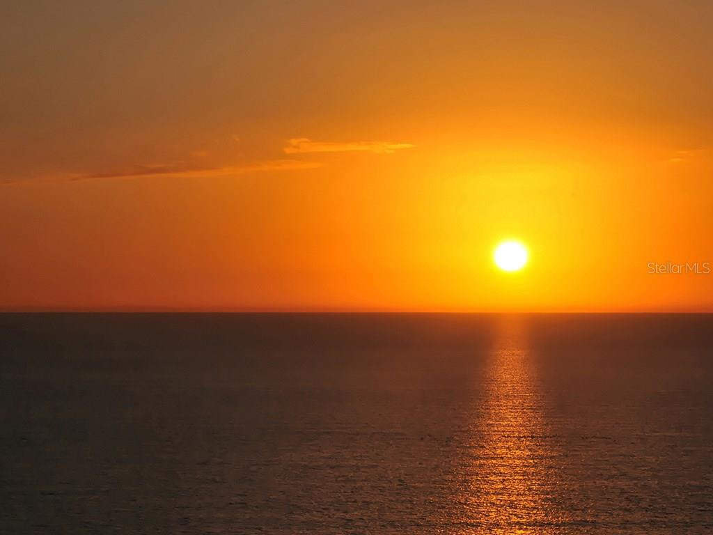 Sunset over Gulf of Mexico - Condo for sale at 1300 Benjamin Franklin Dr #303, Sarasota, FL 34236 - MLS Number is A4181200