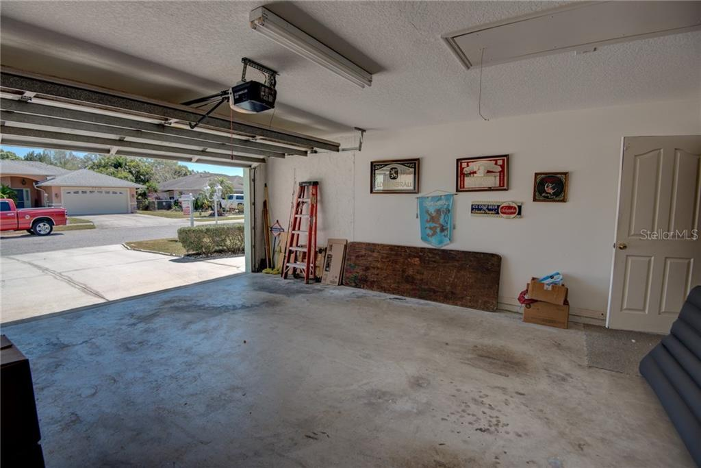 2 car garage with new garage door motor & attic storage - Single Family Home for sale at 7718 36th Ln E, Sarasota, FL 34243 - MLS Number is A4181555