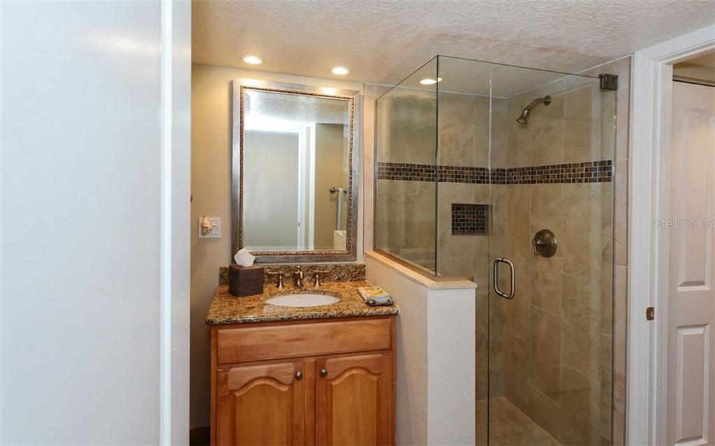 2nd bathroom with shower - Condo for sale at 6263 Midnight Pass Rd #101, Sarasota, FL 34242 - MLS Number is A4182245