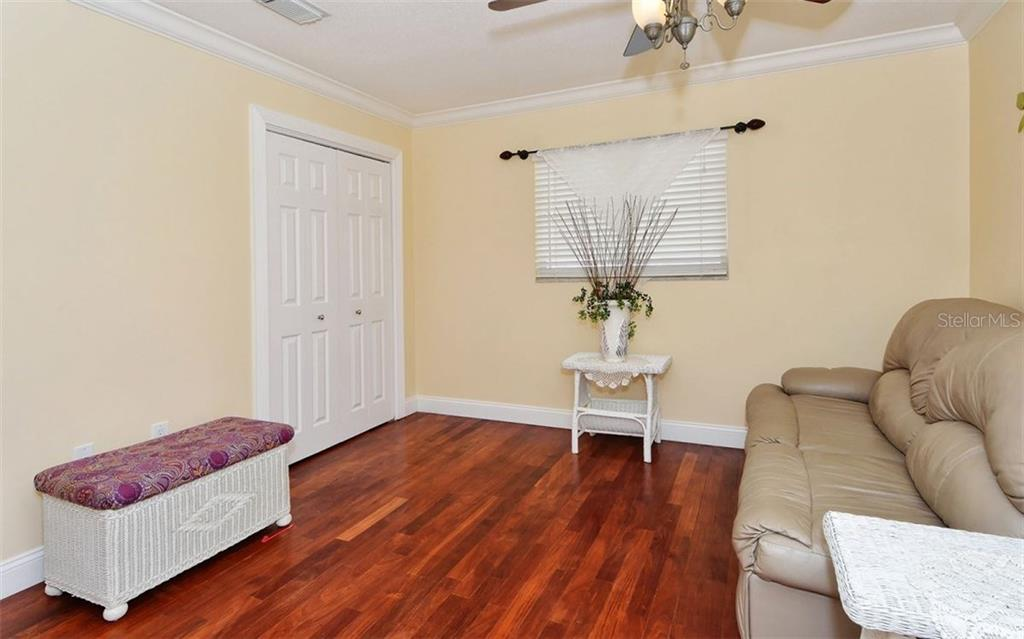 Third bedroom with wood floors and large closet. - Single Family Home for sale at 6239 Hollywood Blvd, Sarasota, FL 34231 - MLS Number is A4182790