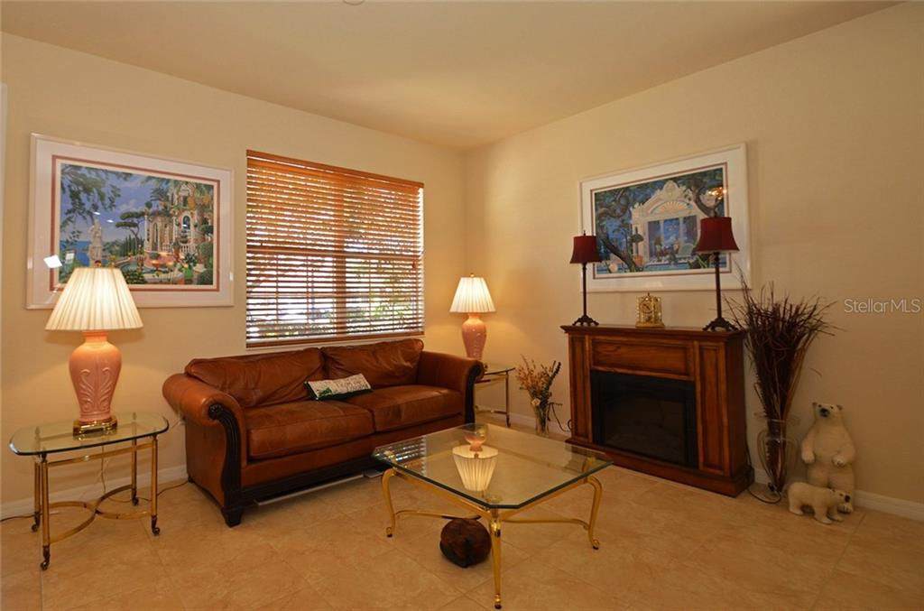 Living Room - Single Family Home for sale at 9006 Heritage Sound Dr, Bradenton, FL 34212 - MLS Number is A4183771