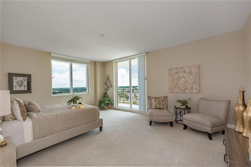 Master bedroom is large enough, tall ceilings included, to arrange a sitting area to the side. - Condo for sale at 800 N Tamiami Trl #1201, Sarasota, FL 34236 - MLS Number is A4184297