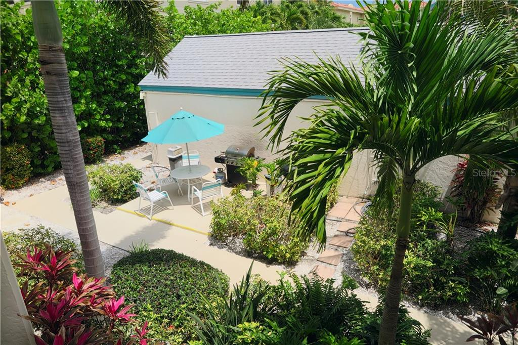 Looking down from walkway outside unit.  Barbecue area - Condo for sale at 100 73rd St #202a, Holmes Beach, FL 34217 - MLS Number is A4184505
