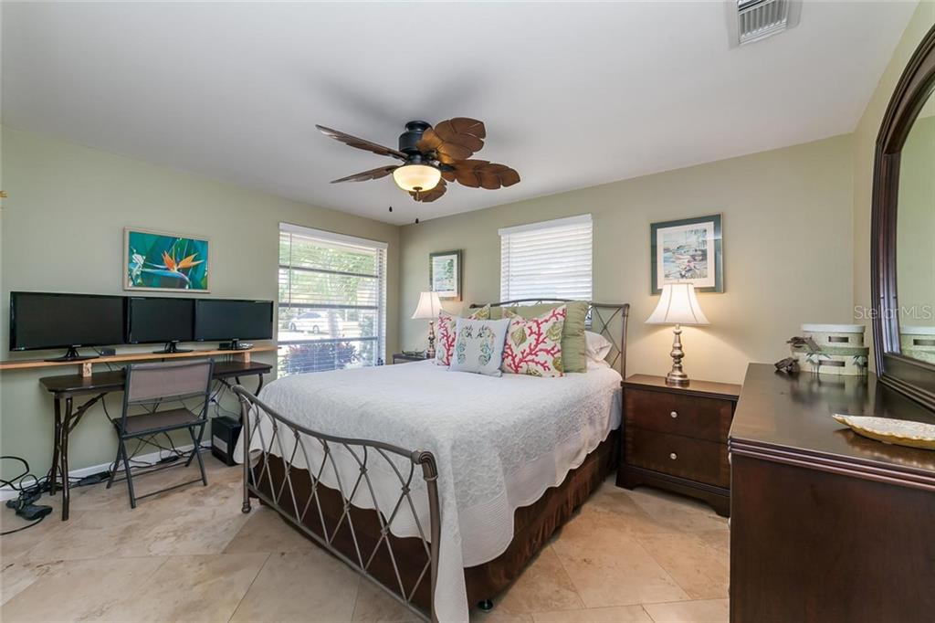 Plenty of light and space in the 2nd bedroom. - Single Family Home for sale at 413 Bay Palms Dr, Holmes Beach, FL 34217 - MLS Number is A4184679