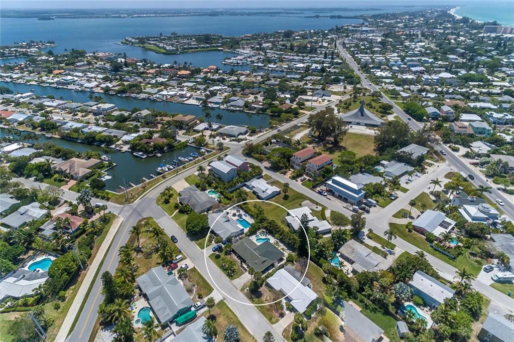 Looking South down Anna Maria Island with the intercoastal to the left and the Gulf of Mexico to the right. - Single Family Home for sale at 413 Bay Palms Dr, Holmes Beach, FL 34217 - MLS Number is A4184679
