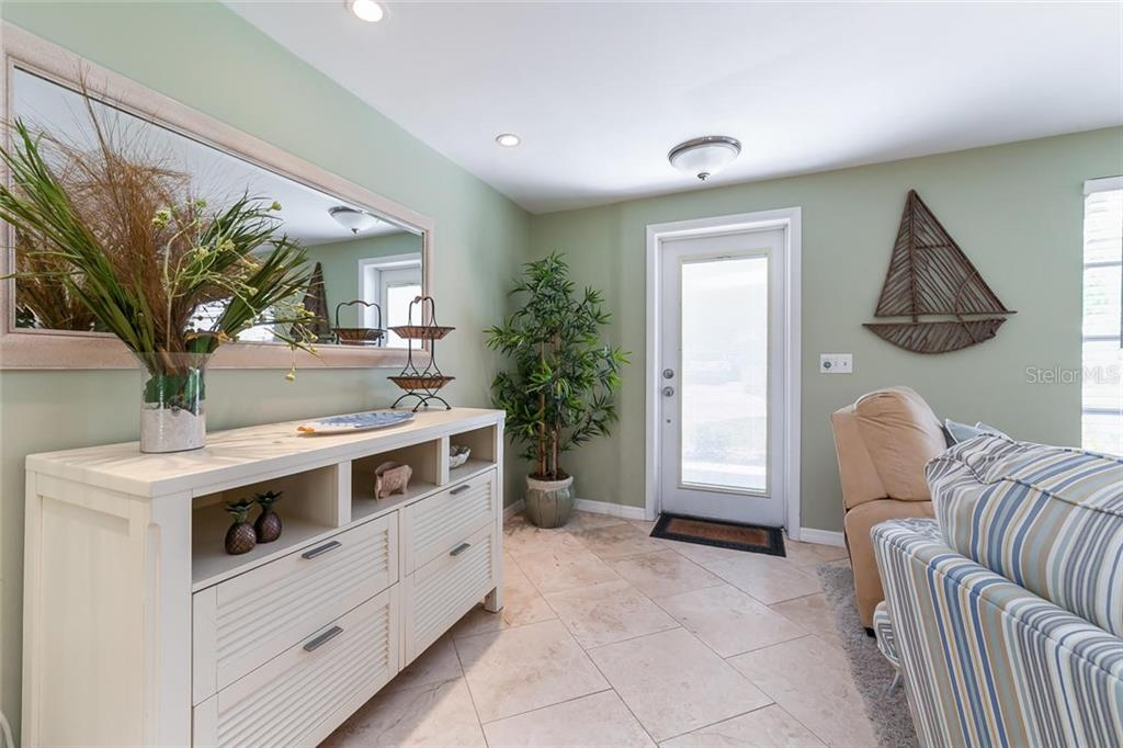 Updated and fresh foyer. - Single Family Home for sale at 413 Bay Palms Dr, Holmes Beach, FL 34217 - MLS Number is A4184679