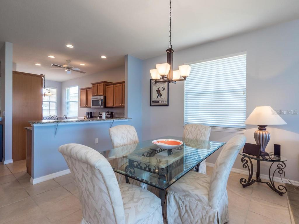 Dining area - Single Family Home for sale at 4294 Reflections Pkwy, Sarasota, FL 34233 - MLS Number is A4185695