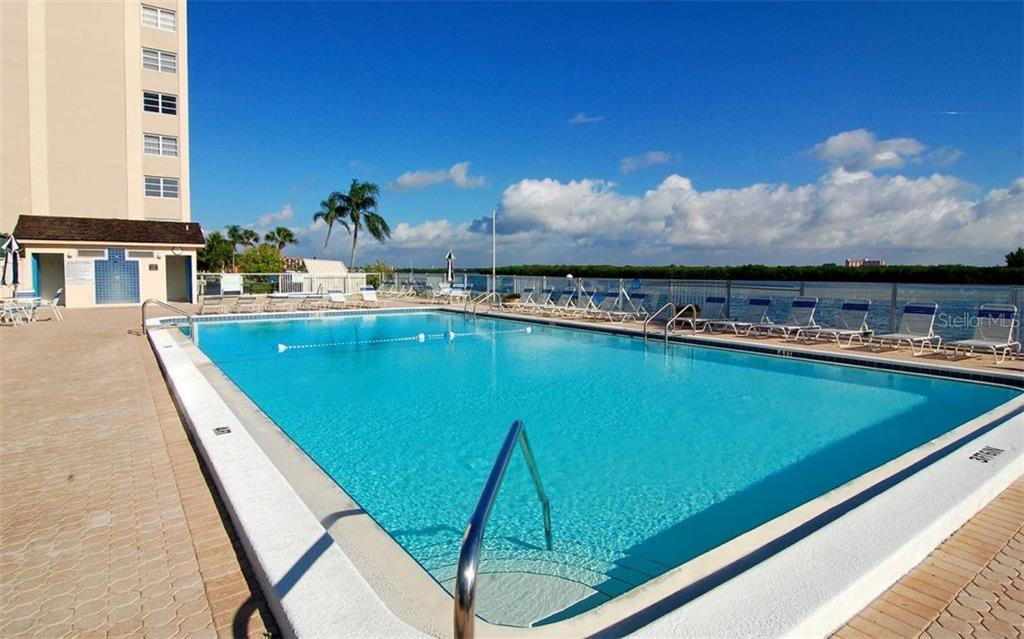 Swimming pool with paver brick sun deck - Condo for sale at 9397 Midnight Pass Rd #403, Sarasota, FL 34242 - MLS Number is A4185842