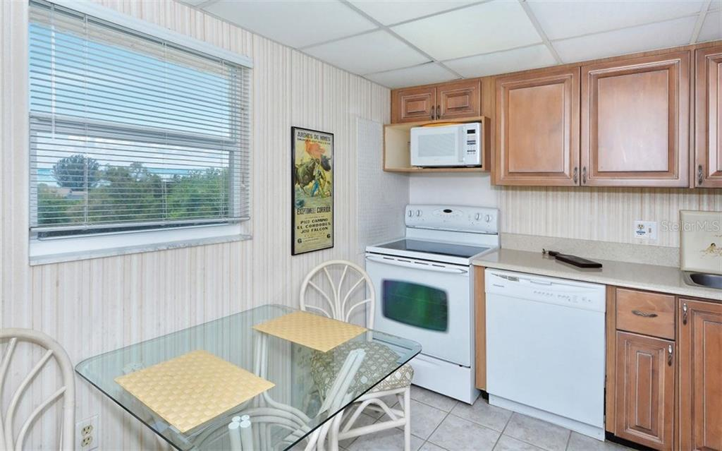 Kitchen with Gulf views - Condo for sale at 9397 Midnight Pass Rd #403, Sarasota, FL 34242 - MLS Number is A4185842