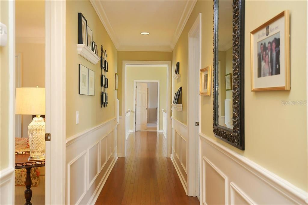 Stunning hallway leading to the wing of the home with the four guest bedrooms. - Single Family Home for sale at 3765 Beneva Oaks Blvd, Sarasota, FL 34238 - MLS Number is A4185879