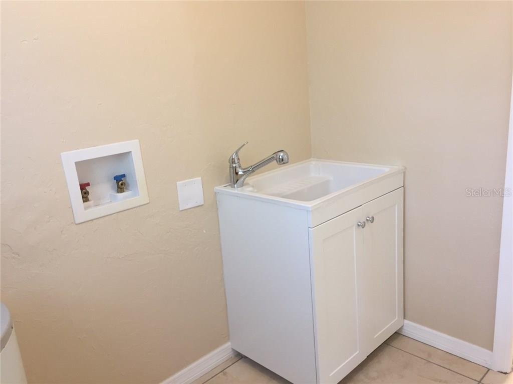 Inside laundry room and new laundry tub. - Single Family Home for sale at 938 Highland St, Sarasota, FL 34234 - MLS Number is A4186423