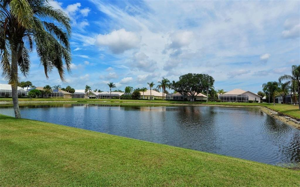 Lake view from pool. 1/4 acre lot - Single Family Home for sale at 4121 Via Mirada, Sarasota, FL 34238 - MLS Number is A4186485