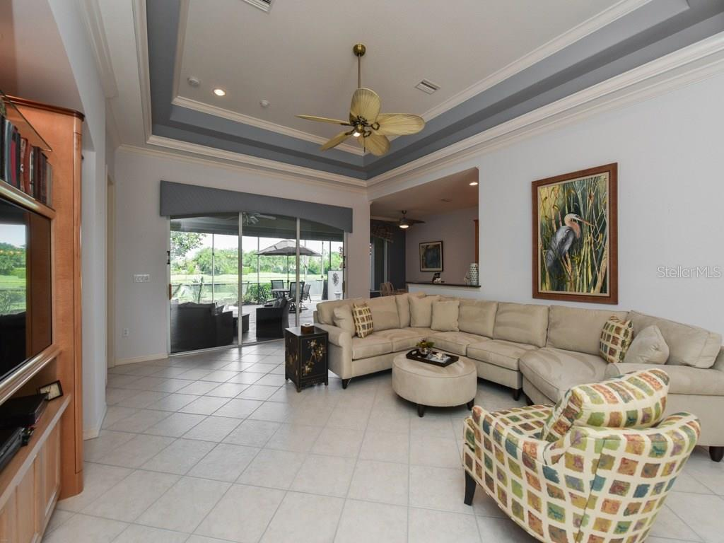 Built-in entertainment center in Great Room, overlooking lanai and amazing tranquil lake view. - Single Family Home for sale at 1307 Copperwood Dr, Osprey, FL 34229 - MLS Number is A4186695