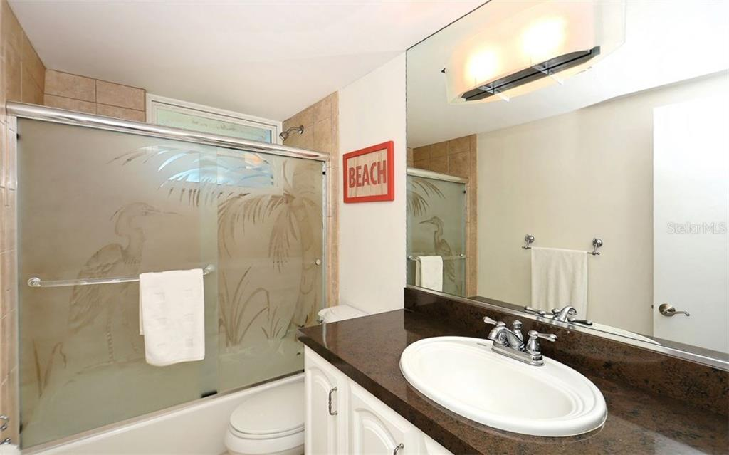 Second Bathroom w/ Tub - Condo for sale at 4330 Falmouth Dr #307, Longboat Key, FL 34228 - MLS Number is A4187329