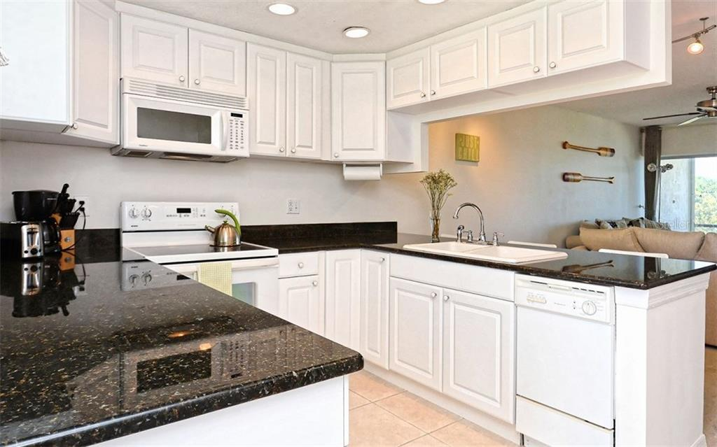 Kitchen - Condo for sale at 4330 Falmouth Dr #307, Longboat Key, FL 34228 - MLS Number is A4187329