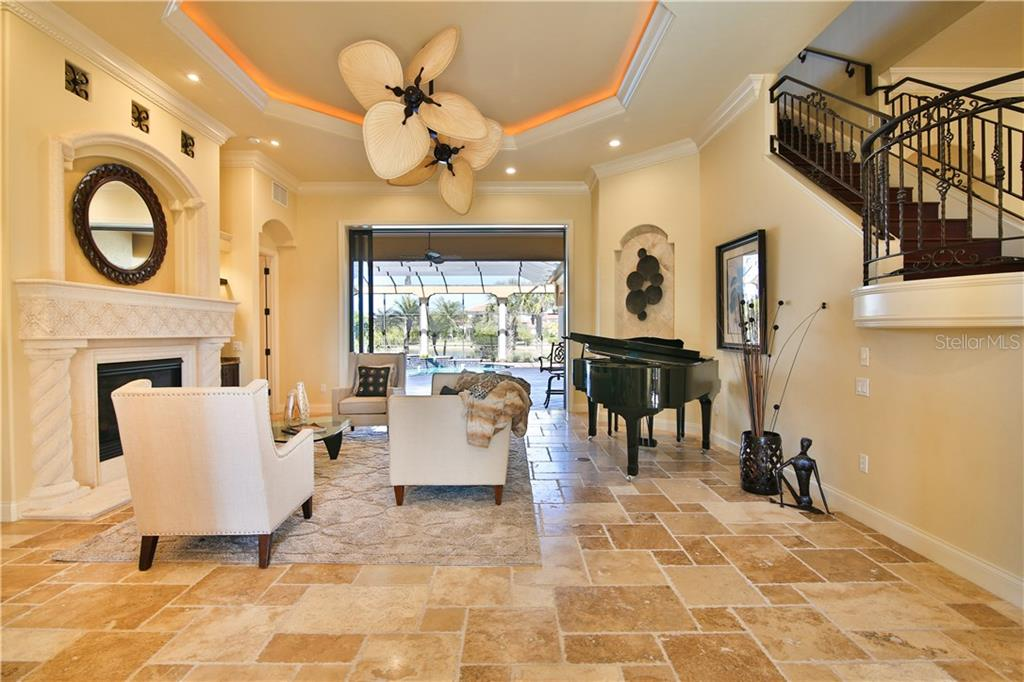 Dining room and what you don't see here is the powder bath to left of front door with onyx sink and exquisite finishes. - Single Family Home for sale at 8365 Catamaran Cir, Lakewood Ranch, FL 34202 - MLS Number is A4187448