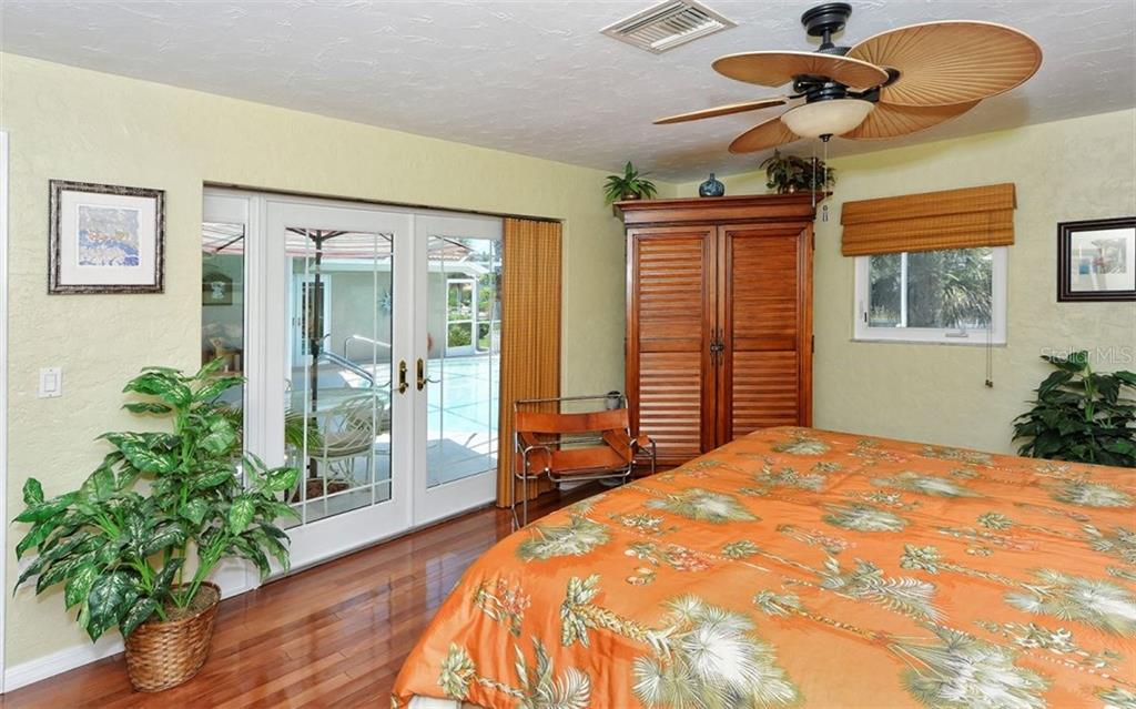 Master suite with french doors to lanai. - Single Family Home for sale at 465 E Royal Flamingo Dr, Sarasota, FL 34236 - MLS Number is A4187554