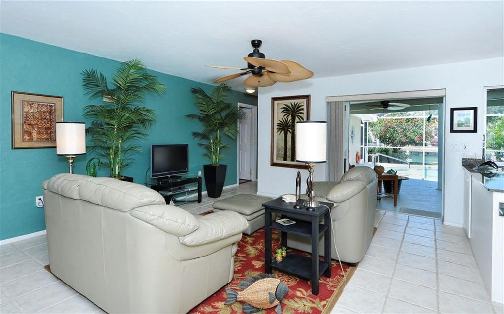 Open family room with sliders to pool & lanai. - Single Family Home for sale at 465 E Royal Flamingo Dr, Sarasota, FL 34236 - MLS Number is A4187554