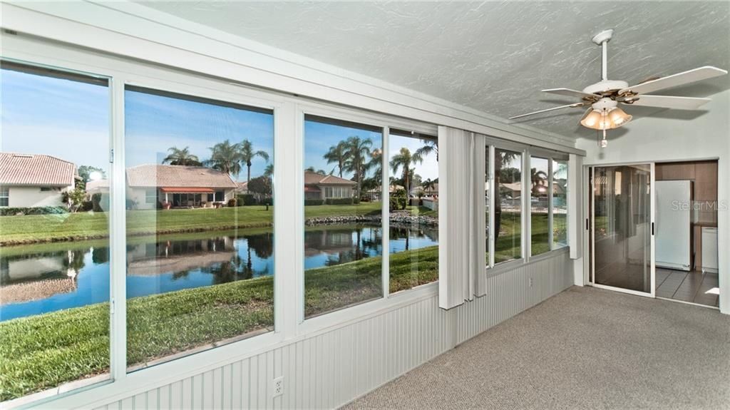 Glass enclosed Florida room with water views. - Single Family Home for sale at 4517 Galloway Blvd, Bradenton, FL 34210 - MLS Number is A4187598