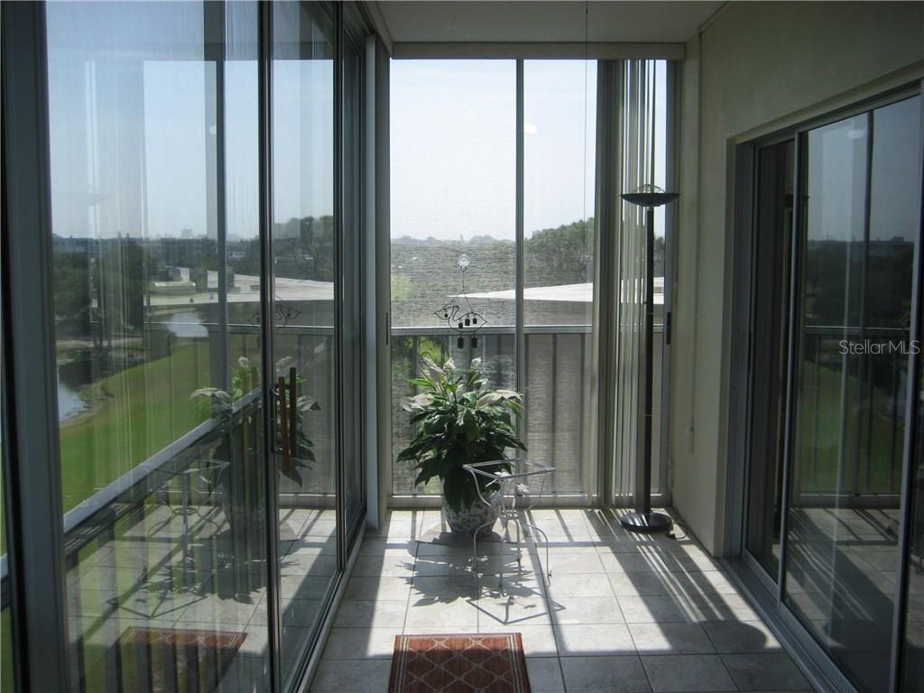 Spacious glass and screen enclosed lanai offers fantastic views of the adjoining golf course - Condo for sale at 3820 Ironwood Ln #606i, Bradenton, FL 34209 - MLS Number is A4187664