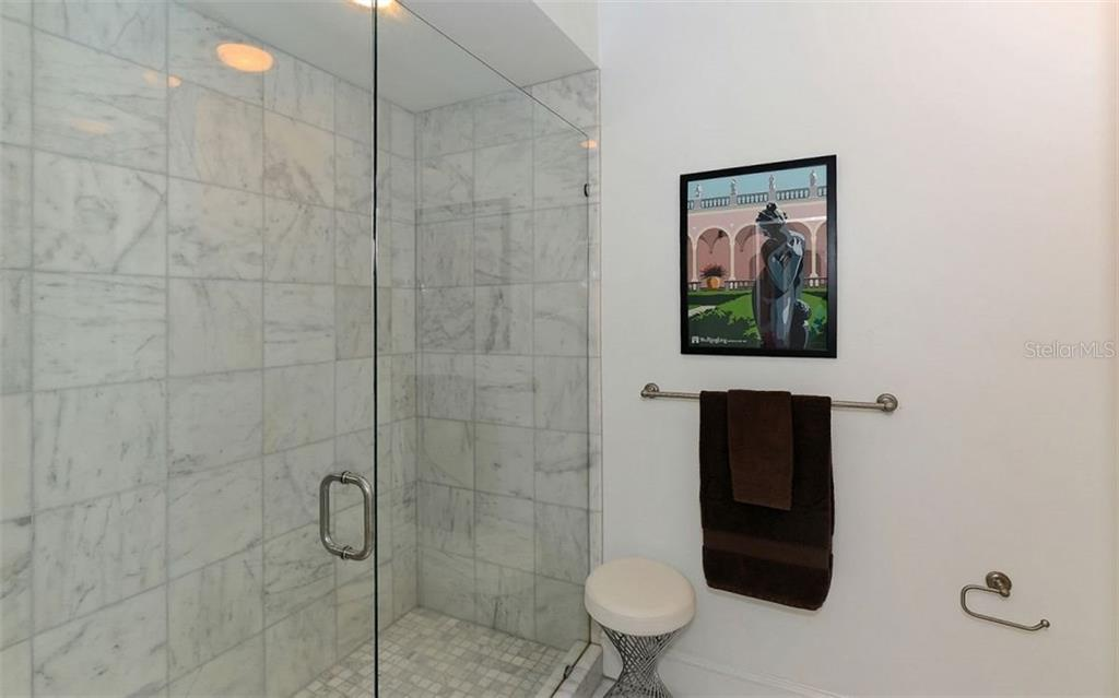 Oversized shower (no tub) with frame-less glass door - Townhouse for sale at 68 Bishops Court Rd #115, Osprey, FL 34229 - MLS Number is A4187983