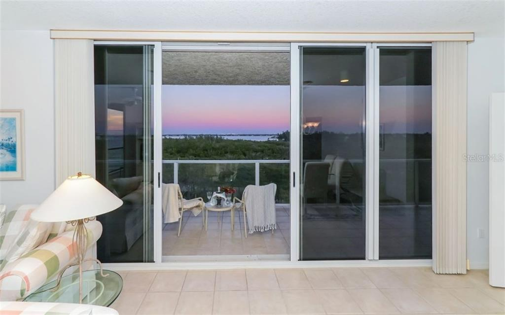 Enjoy partial views of the Gulf from living room - Condo for sale at 1800 Benjamin Franklin Dr #b507, Sarasota, FL 34236 - MLS Number is A4188540