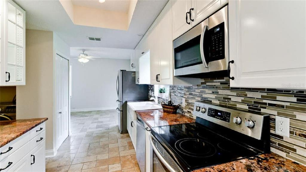 Kitchen updated 2015 including counter tops, cabinets, and all appliances - Single Family Home for sale at 120 Whispering Oaks Ct, Sarasota, FL 34232 - MLS Number is A4188906