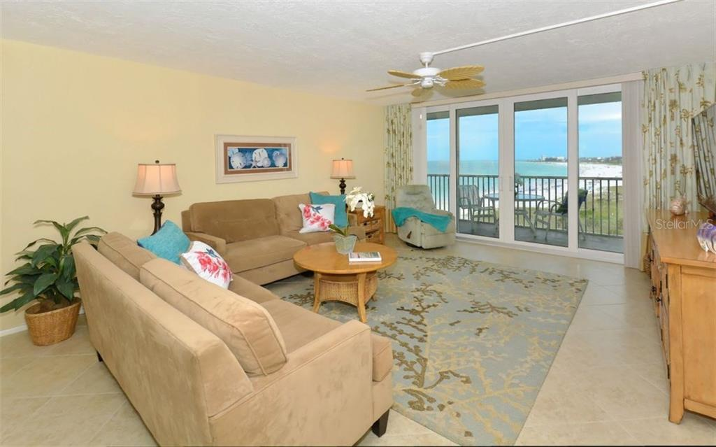 Living room with sliders to terrace with beach and Gulf views - Condo for sale at 6300 Midnight Pass Rd #806, Sarasota, FL 34242 - MLS Number is A4189340