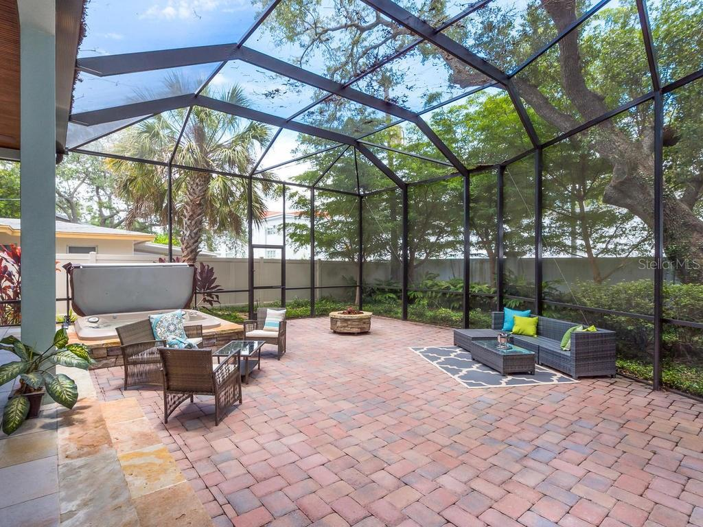 Wonderful screened outdoor entertaining area with pavers, gas firepit and built-in Jacuzzi! - Single Family Home for sale at 1884 Grove St, Sarasota, FL 34239 - MLS Number is A4189365