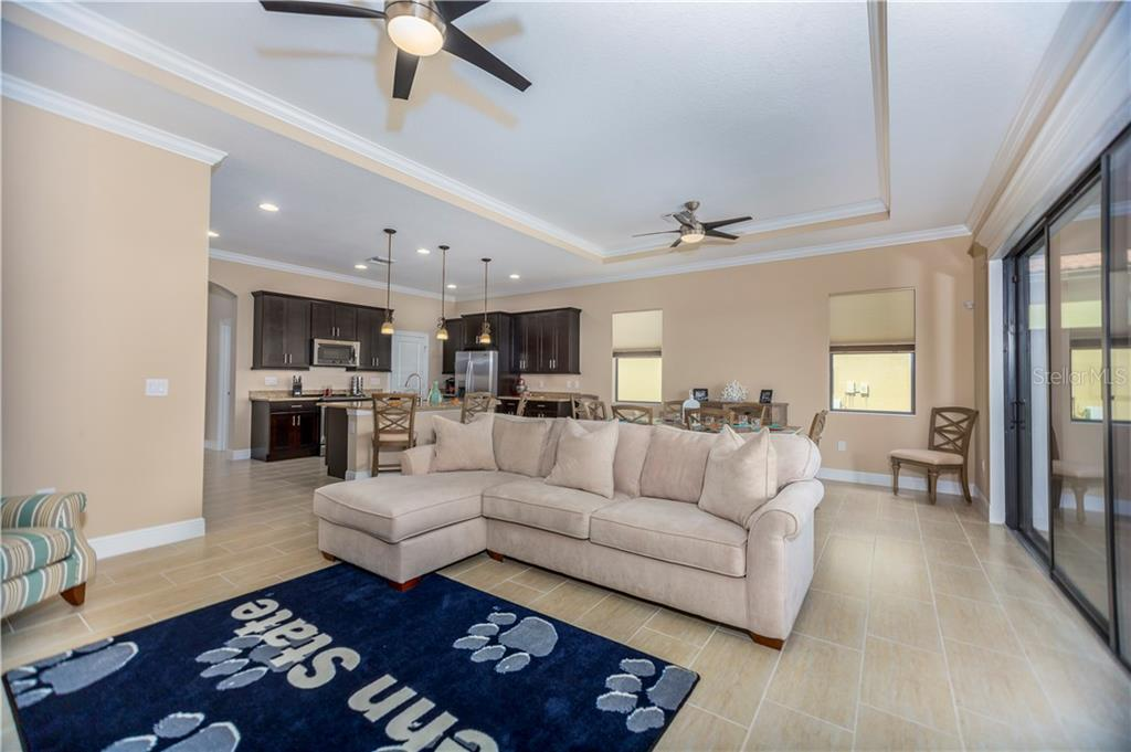 Great room/kitchen - Single Family Home for sale at 23883 Waverly Cir, Venice, FL 34293 - MLS Number is A4190222