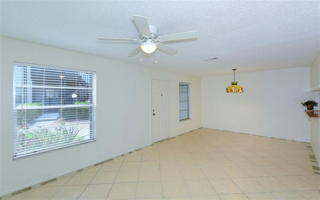 Tiled floors thru-out living areas. - Condo for sale at 3827 59th Ave W #4157, Bradenton, FL 34210 - MLS Number is A4190340