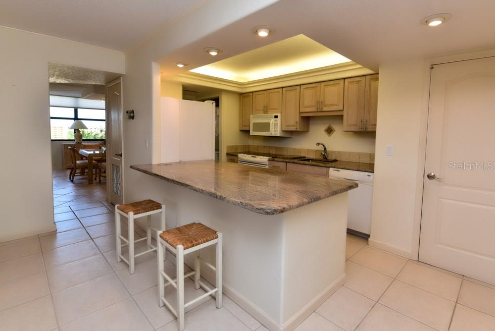 Kitchen with breakfast counter - Condo for sale at 5855 Midnight Pass Rd #628, Sarasota, FL 34242 - MLS Number is A4190416
