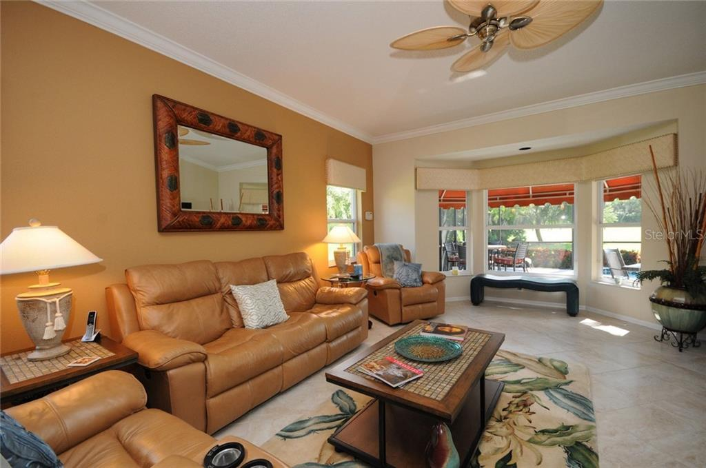 Family room - Villa for sale at 7707 Calle Facil, Sarasota, FL 34238 - MLS Number is A4191635