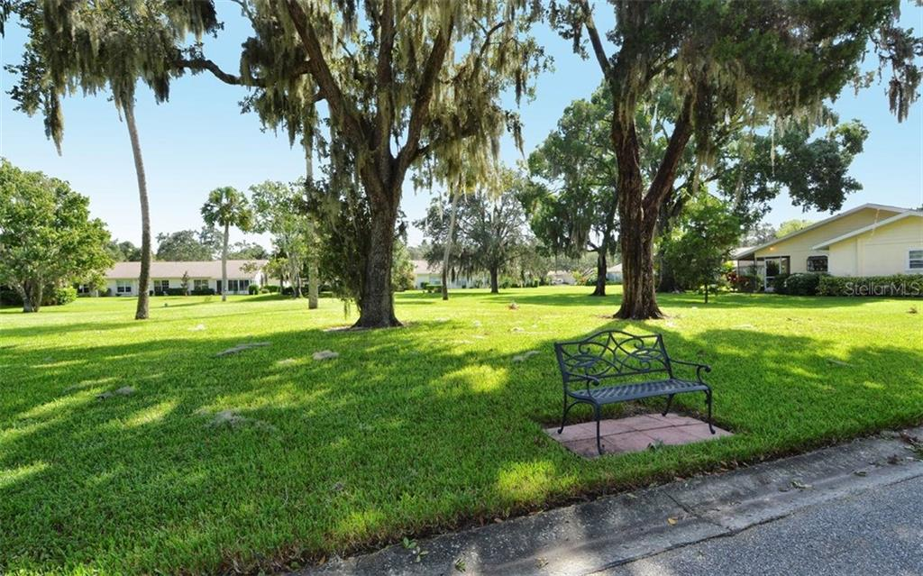 Benches along roads for long walks - Villa for sale at 4248 Oakhurst Cir E #3066, Sarasota, FL 34233 - MLS Number is A4192258