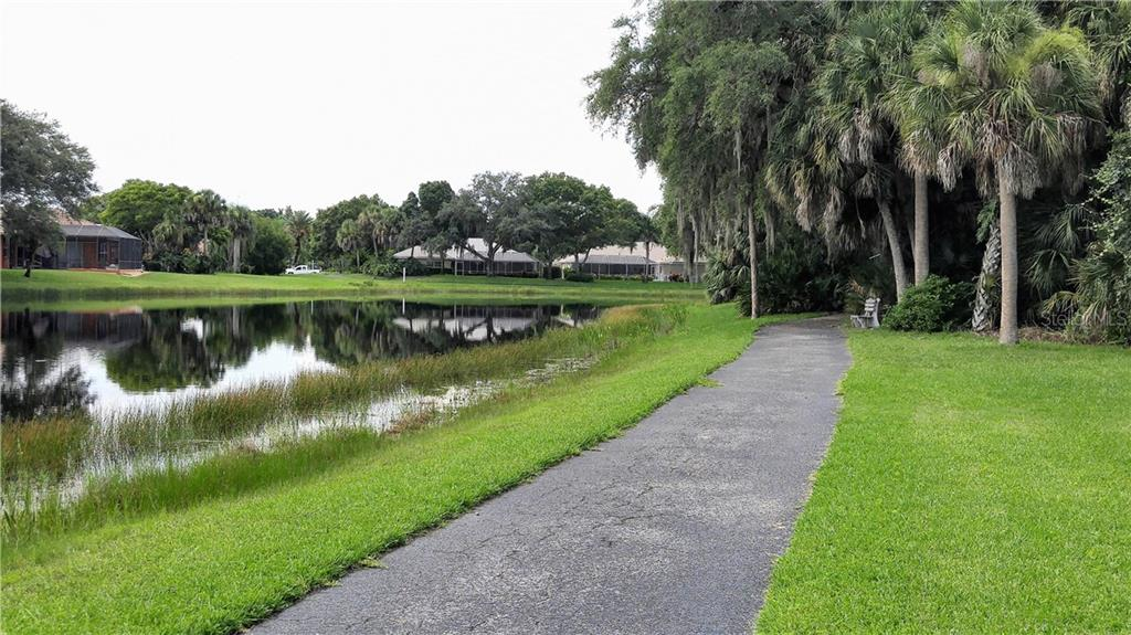 Walking trail along lake - Single Family Home for sale at Address Withheld, Venice, FL 34293 - MLS Number is A4192278