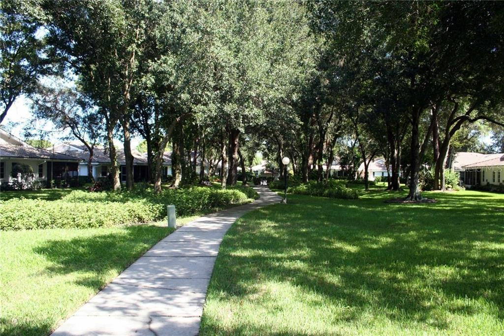 Shaded walking paths throughout the community of 296 units. - Single Family Home for sale at 3610 Garden Lakes Clenet, Bradenton, FL 34203 - MLS Number is A4193334