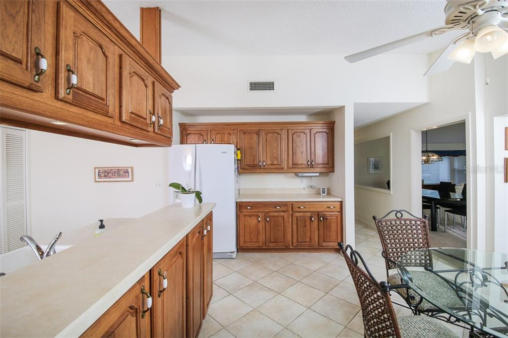 all wood cabinets and ceramic tile floor redone in 2010 - Single Family Home for sale at 3610 Garden Lakes Clenet, Bradenton, FL 34203 - MLS Number is A4193334