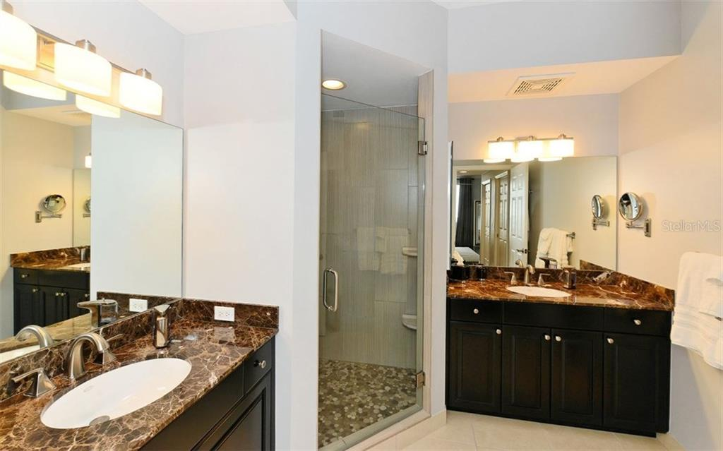 UPDATED MASTER BATHROOM WITH DUAL SINKS, NEW SHOWER WITH SEAMLESS SHOWER DOOR AND A SEPARATE WATER CLOSET. - Condo for sale at 100 Central Ave #h716, Sarasota, FL 34236 - MLS Number is A4193586