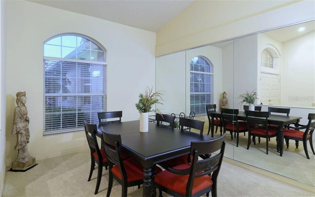 Formal Dining Room - with a wall of mirrors giving a feeling of spaciousness greater than what is already a large Dining Room. - Single Family Home for sale at 3408 Little Country Rd, Parrish, FL 34219 - MLS Number is A4193677