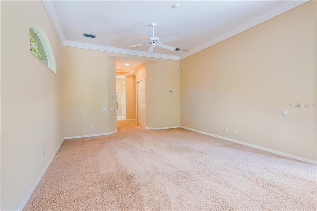 Master bedroom has two separate walk-in closets. - Single Family Home for sale at 8019 Collingwood Ct, University Park, FL 34201 - MLS Number is A4193802