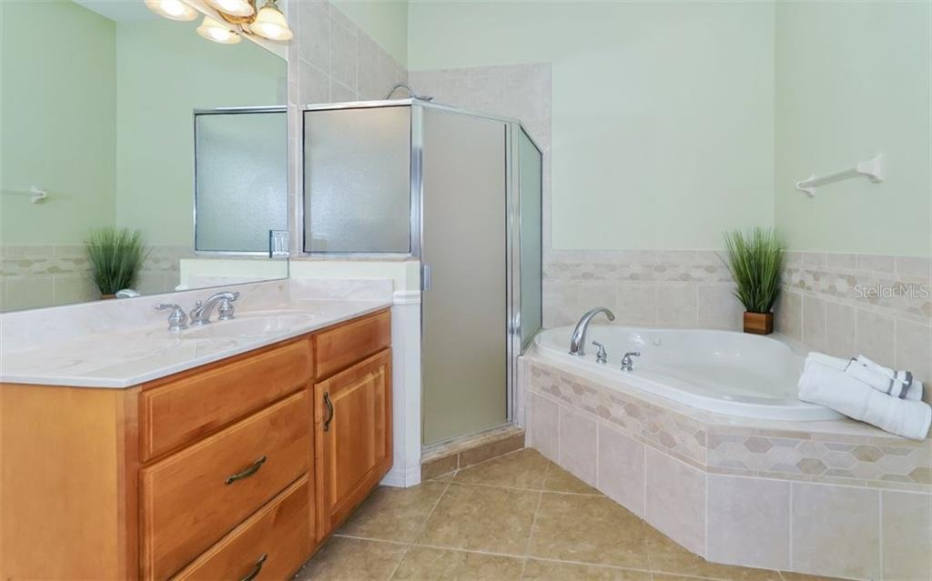 Master bath with tub jets for that relaxing bath after a busy day - Single Family Home for sale at 9818 9th Ave Nw, Bradenton, FL 34209 - MLS Number is A4194125