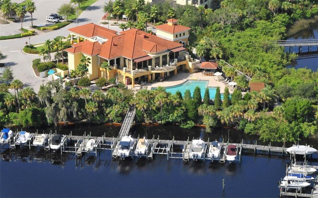 Aerial view of the clubhouse on the Manatee River, boat slips available to lease. - Single Family Home for sale at 9923 Portside Ter, Bradenton, FL 34212 - MLS Number is A4195029