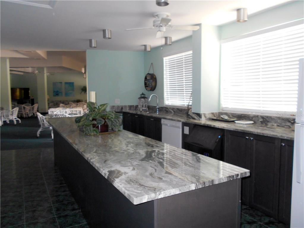 Community room kitchen - Condo for sale at 5855 Midnight Pass Rd #517, Sarasota, FL 34242 - MLS Number is A4195087
