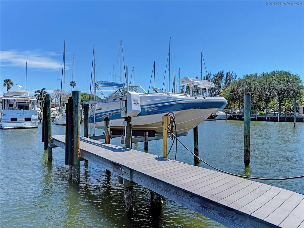 33' boat slip with newer 10,000 lb lift. With electric and fresh water. - Condo for sale at 4106 Marina Ct #622, Cortez, FL 34215 - MLS Number is A4195845