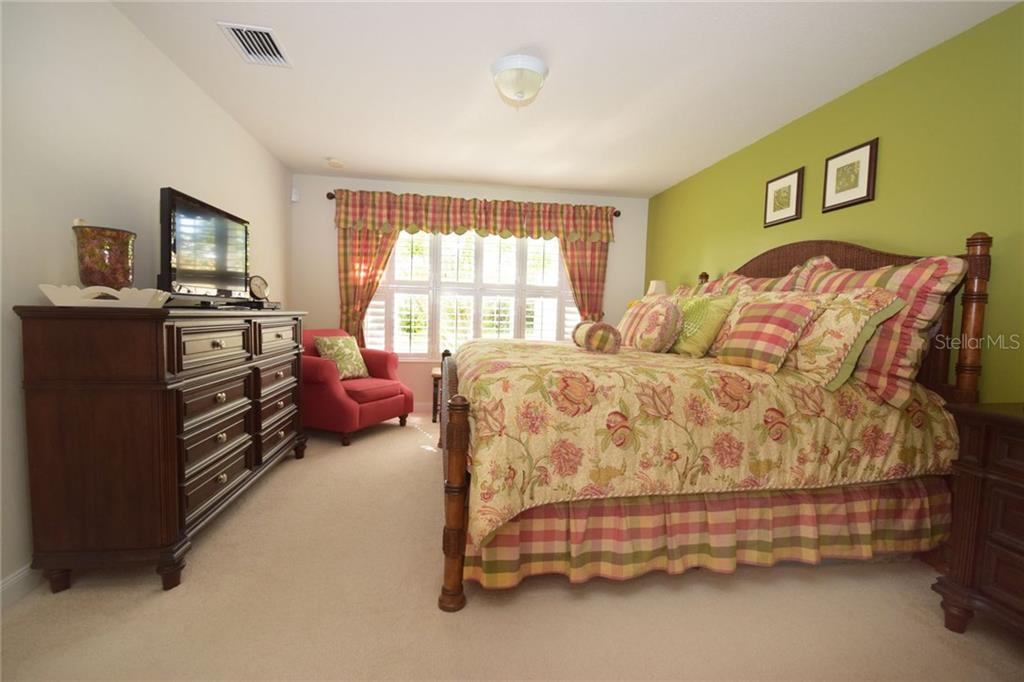 Neutral carpeting in the bedrooms - Villa for sale at 2127 Burgos Dr, Sarasota, FL 34238 - MLS Number is A4195921