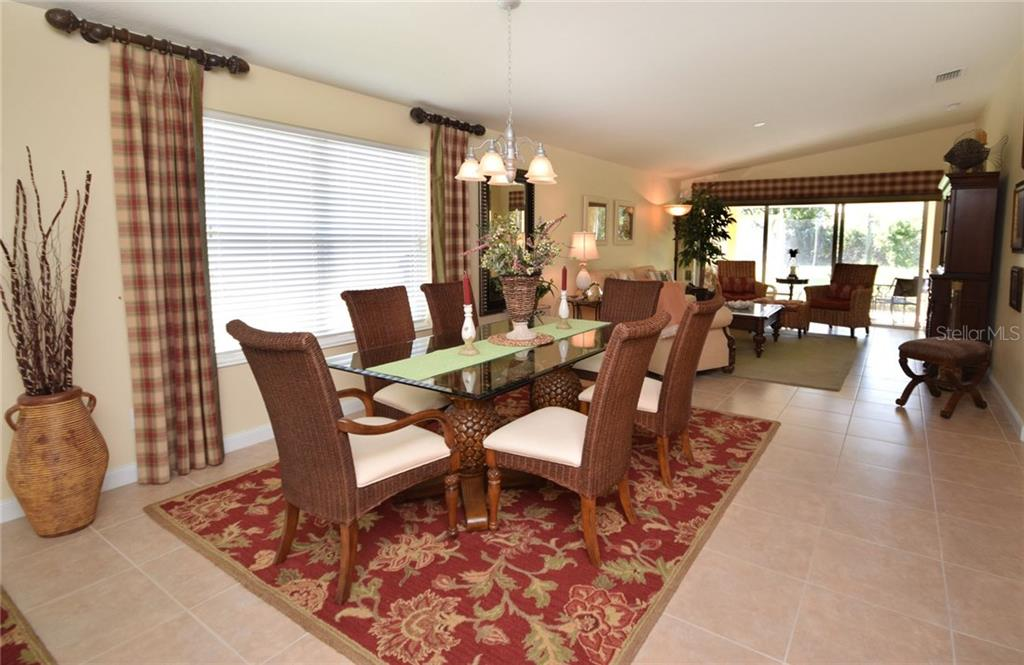 Bright Dining Area with large window - Villa for sale at 2127 Burgos Dr, Sarasota, FL 34238 - MLS Number is A4195921