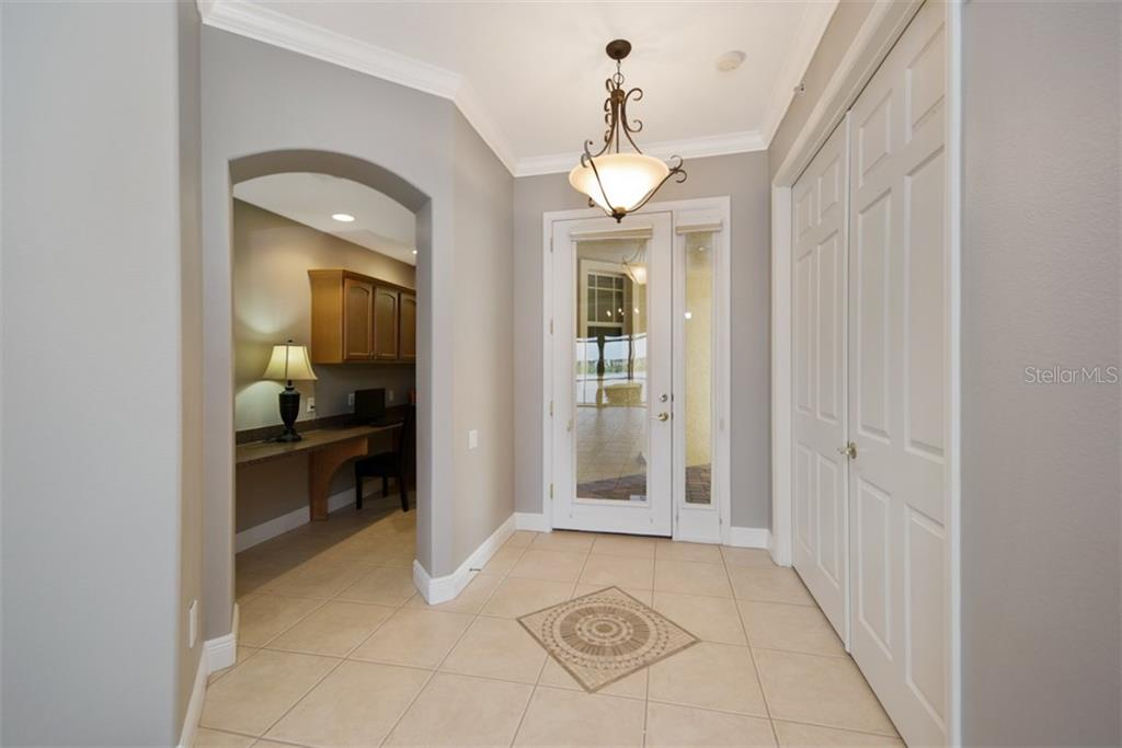 Foyer/entrance.  Beyond is built-in work station. - Condo for sale at 6415 Moorings Point Cir #102, Lakewood Ranch, FL 34202 - MLS Number is A4196054