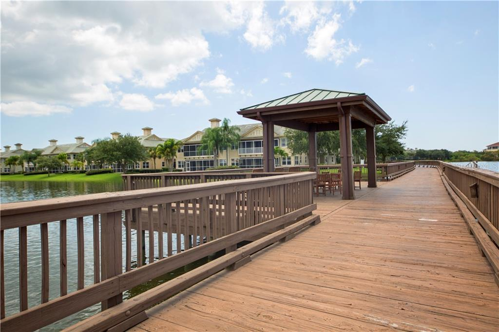 Boardwalk with pavilion that leads to private island and boat launch. - Condo for sale at 6415 Moorings Point Cir #102, Lakewood Ranch, FL 34202 - MLS Number is A4196054